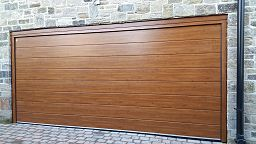oak_sectional_garage_door_with_wireless_remote_control_opening
